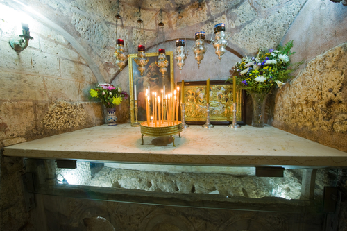 JERUSALEM, ISRAEL - 09 OCT, 2014: The sarcophagus of the The Tomb of the Virgin Mary, the mother of Jesus can be seen through glass