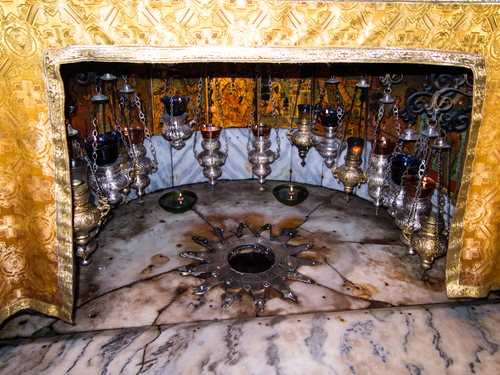 BETHLEHEM - JULY 12, 2015, ISRAEL: A silver star marks the traditional site of the birth of Jesus in Bethlehem's Church of the Nativity, Bethlehem, Israel on July 12, 2015.