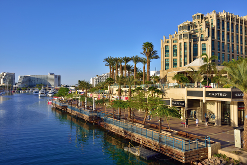 EILAT, ISRAEL - MARCH 31, 2015: Eilat city shown at sunset time, famous international resort - the southest city of Israel