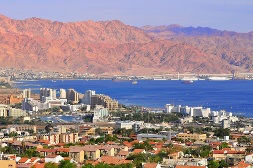 View of Israeli resort city Eilat and Jordan Mountains.